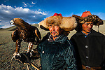 In late afternoon, Kazakh hunters train a golden eagle to respond to commands. For centuries, the Kazakhs, who reside in Western Mongolia, have taken eagle chicks from the nest and hand-trained them to hunt foxes, cats, and, in some cases, wolves. The prey's fur provides the Kazakhs with warm clothing in the harsh, but beautiful, Mongolian winter.