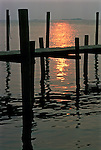 Sunset on Fire Island NY sun reflecting off water Ferry Dock in foreground