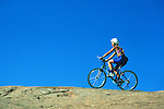 Woman mountain biking in Moab, Utah