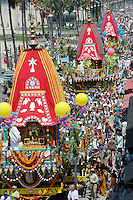 Hare Krishna's pull three fully decorated, four-story chariots south along Ocean Front Walk on Sunday, Aug 05, 2007 during the the 31th Annual  Festival of Chariots. There was a free vegetarian feast for thousands, dancing, exhibits and entertainment.  The festival celebrates Lord Jagannatha, the Lord of the Universe, and is put on by the International Society for Krishna Consciousness (ISKCON). The Festival of the Chariots is now performed in every country across the world and dates back 5 thousand of years to Jagannatha Puri, India. .
