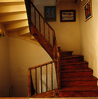 A simple wooden cantilevered staircase