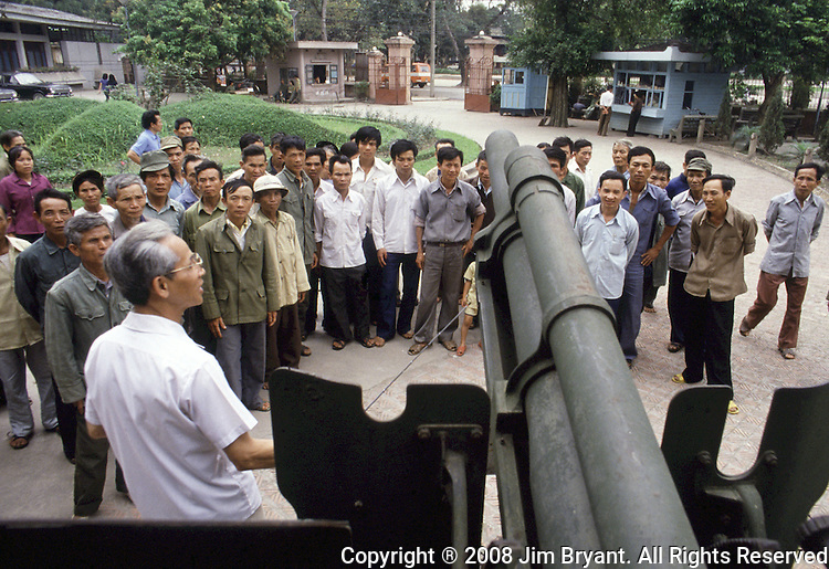 A tour guide points out how an American 105mm howitzer captured from the Chinese Nationalists forces by the Communists Chinese, given to the Vietnamese rebels was used against the French at Dien Bien Phu in Hanoi, North Vietnam.  (Jim Bryant Photo).....