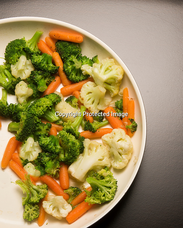 Broccoli Carrot and cauliflower mix in a pan.