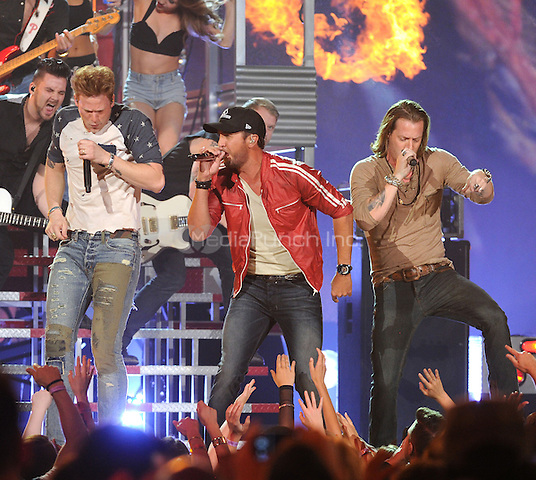 LAS VEGAS, NV - MAY 18: 5 Brian Kelly and Tyler Hubbard of Florida Georgia Line performs with Luke Bryan on the 2014 Billboard Music Awards at the MGM Grand Garden Arena on Sunday, May 18, 2014 in Las Vegas, Nevada.PGMicelotta/MediaPunch