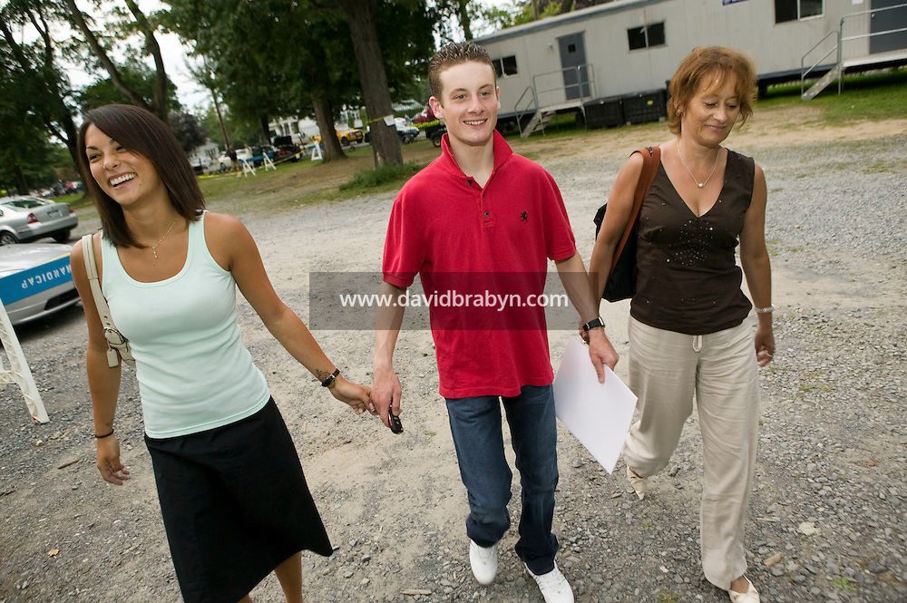 Jockey Julien Leparoux (C), accompanied by his mother Nicole(R) and girlfriend Michelle Yu who are visiting him for a few days, leave the Saratoga race track after a day of racing at Saratoga Springs, NY, United States, 14 August 2006.