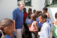 "28 November 2008, Ivory Park, South Africa. Ivan Lewis, UK Minister for International Development, visits an HIV/AIDS orphanage - Tshwaranang, which means ""stand together"" in Sotho."