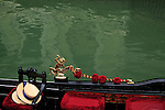 A close up view of a gondola in a canal of Venice, Italy.