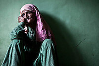 """Zoona sobs grief-stricken as she remembers her lost son. She is mother of Abdul Amid, a Muslim militant arrested by Indian army and disappeared under custody. In accord with human rights organizations, the case of Zoona's son's disappearance, as the other 8,000 cases of enforced disappearance, are not recognized by the Indian government. Thus, the victims of enforced disappearance are not declared neither """"dead"""" nor """"alive"""", and the relatives mourn in silence for their son, daughter, wife or husband, without any trace of bodies or grave of its existence. Plarhar village, Baramulla district, Indian administrated Kashmir."""