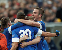 Creighton University midfielder Christian Blandon (20) celebrates his goal with teammates. .NCAA Tournament. Creighton University (blue) defeated University of Connecticut (white), 1-0, at Morrone Stadium at University of Connecticut on December 2, 2012.
