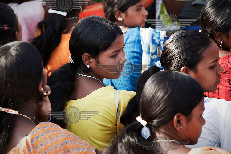 Women sit and listen to speeches at a protest rally by Santal Adavesi tribespeople, on the West Bengal / Jharkhand border. They are demonstrating against the destruction of their land as a consequence of the excavation of a stone quarry.