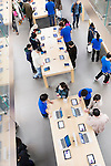 People at Apple store trying new iPhones, iPads and MacBooks. Ginza, Tokyo, Japan 2014