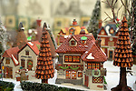 Garden City, New York, USA. December 1, 2013. The Winter holiday Festival of Trees has elaborate displays, including the Mr. Wickfield Solicitor building in the Dickens Village by Department 56. The event was held at Cradle of Aviation Museum during Thanksgiving weekend, with proceeds benefiting United Cerebral Palsy Association of Nassau Count, Long Island.