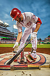 20 May 2014: Washington Nationals outfielder Kevin Frandsen prepares his bat on deck during play against the Cincinnati Reds at Nationals Park in Washington, DC. The Nationals defeated the Reds 9-4 to take the second game of their 3-game series. Mandatory Credit: Ed Wolfstein Photo *** RAW (NEF) Image File Available ***