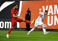Washington, D.C.- May 29, 2014. Honduras defender Emilio Izaguirre goes against Turkey defender Tarik Camdal.  Turkey defeated Honduras 2-0 during an international friendly game at RFK Stadium.