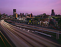 BI52,600-01...WASHINGTON - A 1969 photograph of Interstate 5 passing through downtown Seattle at sunset.