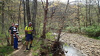 NWA Democrat-Gazette/FLIP PUTTHOFF <br /> Alan Bland (from left), Terry Stanfill and Gene Williams hike April 14 2017 along a creek that joins the Kings River at Kings River Falls Natural Area.