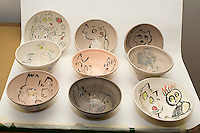 Ceramic pottery, bowls, cups, plates, with bird and cat drawings for 2016 Holiday Sale by Frances M. Roberts. (© Frances M. Roberts)