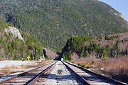 "Railroad tracks next to Crawford Train Depot (Conway Scenic Railroad) at the start of Crawford Notch State Park in the White Mountains, New Hampshire USA. The rock profile known as ""Elephant Head""  can be seen on the left"