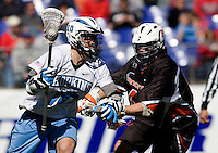 Steven Boyle (10) of Johns Hopkins tries to moves towards goal past  Long Ellis (41) of Princeton during the Face-Off Classic in at M&T Stadium in Baltimore, MD