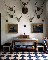 Sets of antlers are dsiplayed on the marbleised wall of the entrance hall
