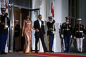 US President Barack Obama (R) and First Lady Michelle Obama (L) walk outside to greet Italian Prime Minister Matteo Renzi and Italian First Lady Agnese Landini prior to the state dinner at the White House in Washington DC, USA, 18 October 2016. President Obama and First Lady Michelle Obama are hosting their final state dinner featuring celebrity chef Mario Batali and singer Gwen Stefani performing after dinner. <br /> Credit: Shawn Thew / Pool via CNP