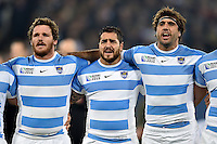 Lucas Noguera, Horacio Agulla and Juan Martin Fernandez Lobbe of Argentina sing their national anthem. Rugby World Cup Bronze Final between South Africa and Argentina on October 30, 2015 at The Stadium, Queen Elizabeth Olympic Park in London, England. Photo by: Patrick Khachfe / Onside Images