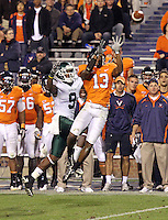 Oct 23, 2010; Charlottesville, VA, USA;  Virginia Cavaliers cornerback Chase Minnifield (13) intercepts the ball in front of Eastern Michigan Eagles wide receiver Tyrone Burke (9) during the game at Scott Stadium.  Virginia won 48-21. Mandatory Credit: Andrew Shurtleff