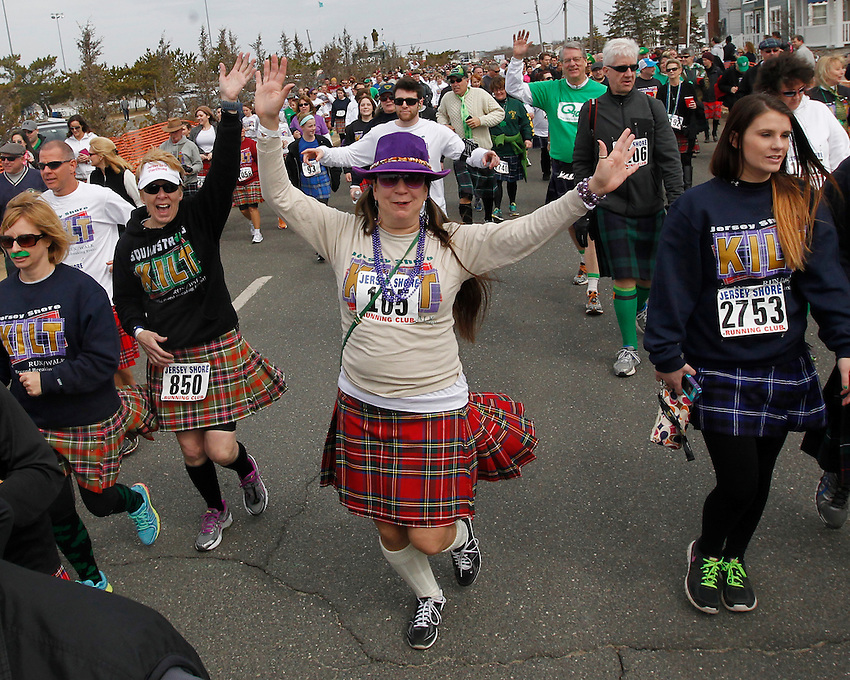 Manasquan's Lori Triggiano is one of more than 3,000 participants at the world-record breaking 2014 Jersey Shore Kilt Run 2-mile race at the Manasquan beachfront on Sat., March, 22, 2014.