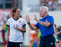 Stephanie Cox (19) of the USWNT talks with head coach Tom Sermanni during an international friendly at the Florida Citrus Bowl in Orlando, FL.  The USWNT defeated Brazil, 4-1.