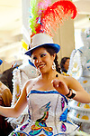 Dancer in Spanish/Bolivian traditional dress and hat celebrating Independence Day in La Paz, Bolivia.