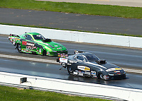 Sep 5, 2016; Clermont, IN, USA; NHRA top alcohol funny car driver Jonnie Lindberg (near) races alongside Doug Gordon during the US Nationals at Lucas Oil Raceway. Mandatory Credit: Mark J. Rebilas-USA TODAY Sports