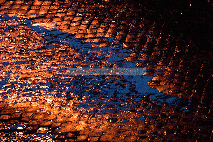 Water puddle on cobbled stones, Rome, Italy