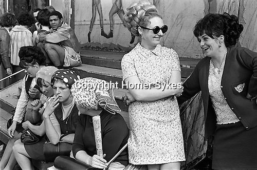 Girls outside Pat McKeowen's prize fighting fairground boxing booth. The Derby Horse Race Epsom Downs. Surrey England 1969.