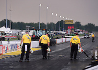 Sept. 1, 2012; Claremont, IN, USA: NHRA safety safari track crews use air blowers to help dry the track during a rain delay to qualifying for the US Nationals at Lucas Oil Raceway. Mandatory Credit: Mark J. Rebilas-
