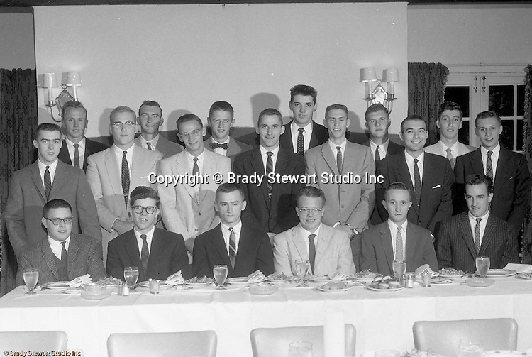 Pittsburgh PA:  View of the Caddies receiving college scholarships from the Western Pennsylvania Golf Association's Caddie Welfare Foundation for year 1957.  The Foundation was managed by Fidelity Trust Company and scholarships are agreed upon by the WPGA executive committee. This dinner was held at the Longue Vue Country Club in Penn Hills and the assignment was for Charles K. Robinson. The mission of the WPGA are to sanction championships, establish handicapping and rate area golf courses.