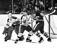 Seals vs Buffalo Sabres, #4 Wayne Muloin holds Gerry Meehan away from goalie Gary Smith..(1971 photo/Ron Riesterer)