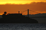 The sun rose over some famous San Francisco landmarks, Coit Tower and Alcatraz Island in California.