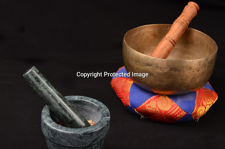 Stock photo of holistic herbs and bell