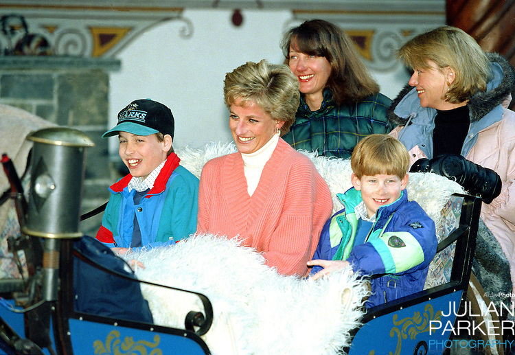 Diana, The Princess of Wales, Prince William and Prince Harry, ride in a horse drawn sleigh, in Lech Austria, during their annual ski holiday, accompanied by the Princess's friends Catherine Soames, and Kate Menzies