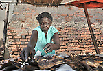 Edina Keji sells dried shrimp in the market in Yei, Southern Sudan, supported by a microfinance program run by the United Methodist Women in Yei.