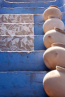 The blue-painted steps leading up to this house are lined with terracotta pots