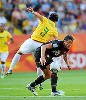 Abby Wambach (r) of team USA and Daiane of team Brazil during the FIFA Women's World Cup at the FIFA Stadium in Dresden, Germany on July 10th, 2011.