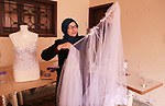 Manar Tafesh, 30, a Palestinian fashion designer works on knitting wedding dresses at her house with her husband to help him after he lost his work as tailor in the Palestinian territory occupied, in Gaza city on Feb. 14, 2017. The Gaza Strip is suffering from unemployment especially after Israel stopped the permits to Palestinian laborers from the Gaza Strip with the outbreak of the second, Al-Aqsa intifada on Sept. 27, 2000 and Israeli blockade on the Gaza Strip, Which made the population in the Gaza Strip resort to finding an alternative plan to improve living conditions. Photo by Reham Al Gazaly