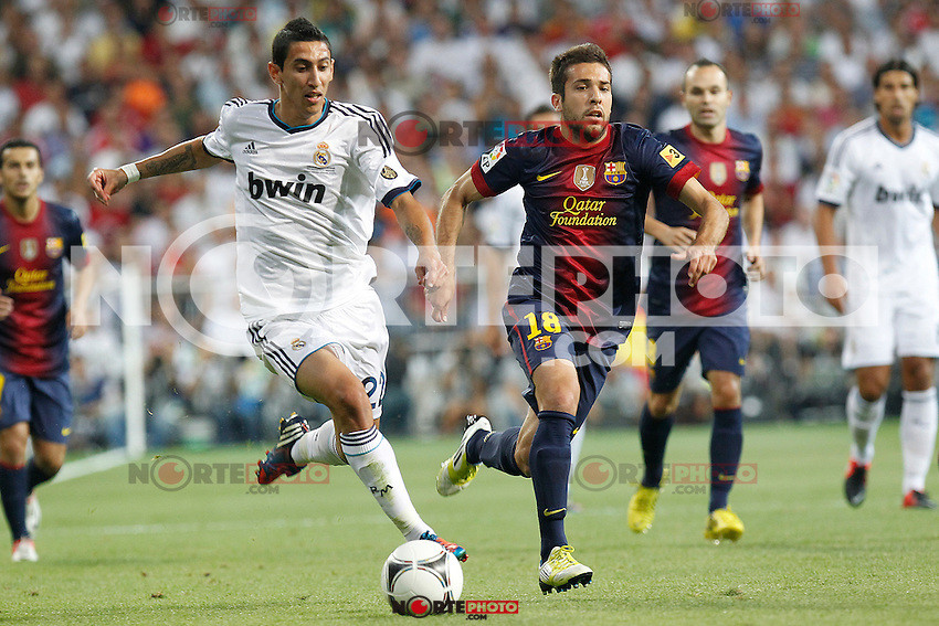 Real Madrid's Angel di Maria and F.C. Barcelona's Jordi Alba during Spanish Supercup 2nd match on august 29 2012...Photo: Alex Cid-Fuentes / ALFAQUI /NortePhoto.com<br />