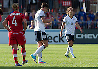 02 June 2013: U.S. Women's National Team forward Abby Wambach #20 celebrates the win at the end of an International Friendly soccer match between the U.S. Women's National Soccer Team and the Canadian Women's National Soccer Team at BMO Field in Toronto, Ontario.<br /> The U.S. Women's National Team Won 3-0.
