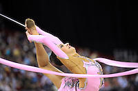 Evgeniya Kanaeva of Russia pirouettes in ring position with ribbon at 2009 Budapest World Cup on March 7, 2009 at Budapest, Hungary.  Photo by Tom Theobald.