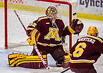 24 November 2012: University of Minnesota Golden Gopher goaltender Adam Wilcox, a Freshman from South St. Paul, MN, makes a third period save against the University of Vermont Catamounts at Gutterson Fieldhouse in Burlington, Vermont. The Gophers defeated the Catamounts 3-1 in the second game of their 2-game non-divisional weekend series. Mandatory Credit: Ed Wolfstein Photo