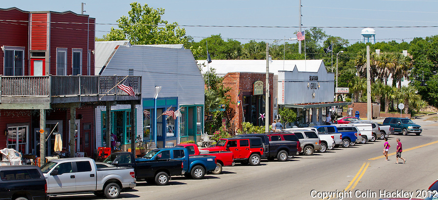 Visitors cross U.S. Highway 98 in Apalachicola's business district..COLIN HACKLEY PHOTO