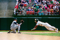 OAKLAND, CA - Rickey Henderson of the Oakland Athletics gets thrown out trying to steal second base during a game against the New York Yankees at the Oakland Coliseum in Oakland, California in 1991. Photo by Brad Mangin