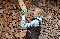 Young Caucasian Woman Stacking Firewood